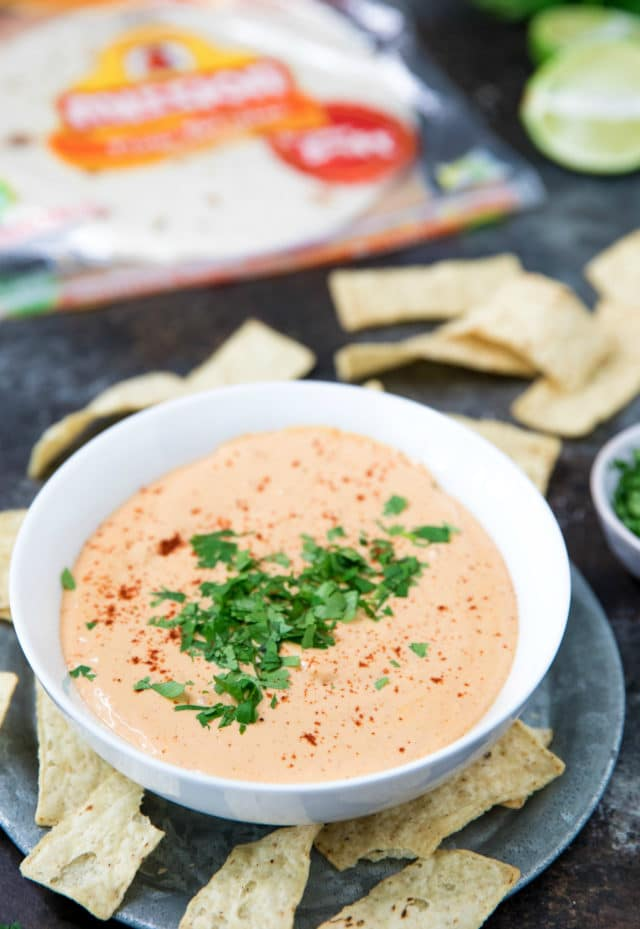 easy chipotle ranch dip served on a metal plate with tortilla chips