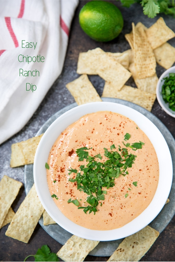 easy chipotle ranch dip served in a white bowl with tortilla chips