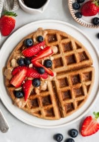 waffle topped with berries and almond butter
