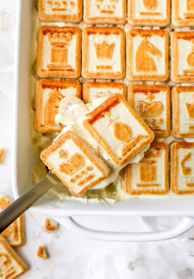 serving banana pudding out of a white dish