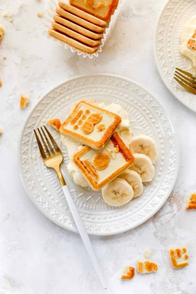 banana pudding on a white plate with Chessman cookies on top