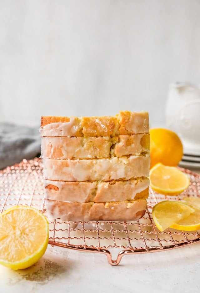slices of lemon pound cake stacked on a wire cooling rack