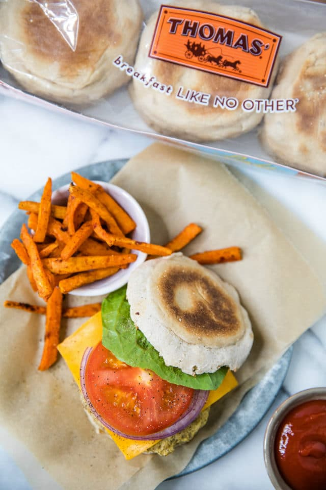 English muffin turkey burger served with sweet potato fries