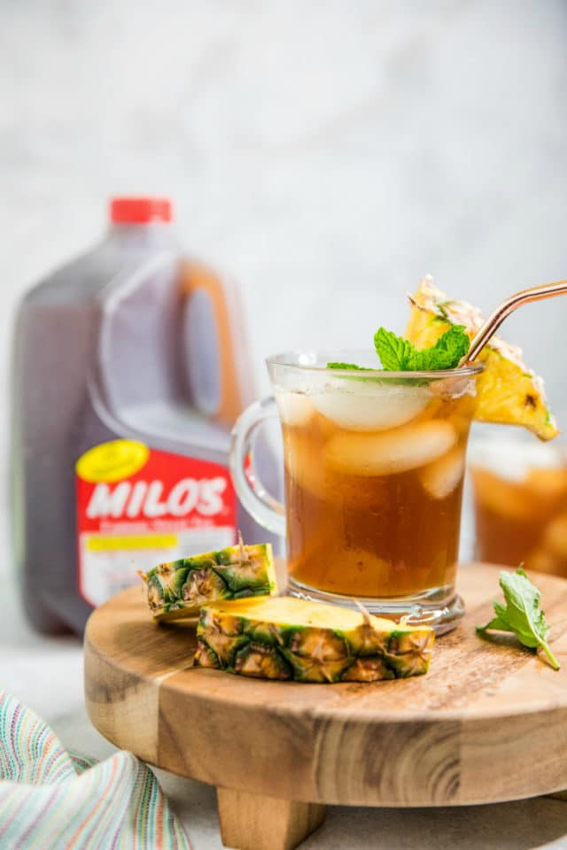 pineapple sweet tea near a gallon jug of Milo's sweet tea