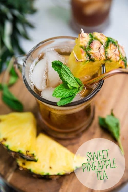 Pineapple Sweet Tea served with pineapple chunks and sprigs of mint