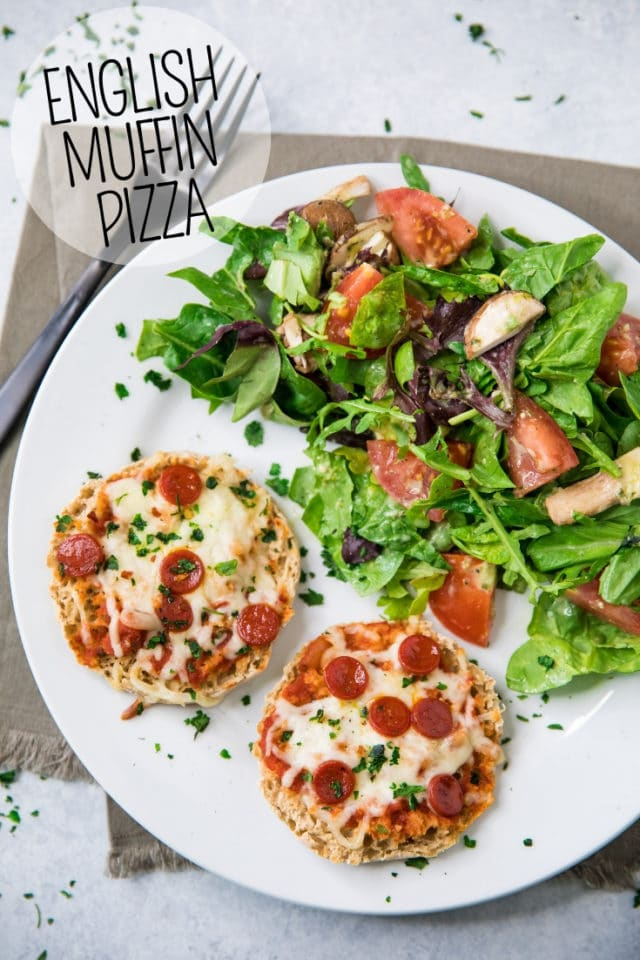 English Muffin Pizzas on a white plate served with a side salad