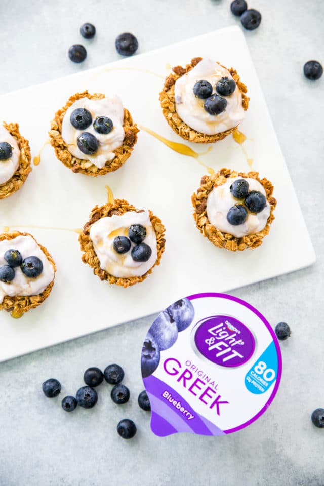 Granola Yogurt tarts on a white serving plate with Dannon Light and Fit yogurt