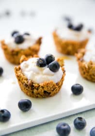 Granola Yogurt Cups on a white tray topped with blueberries