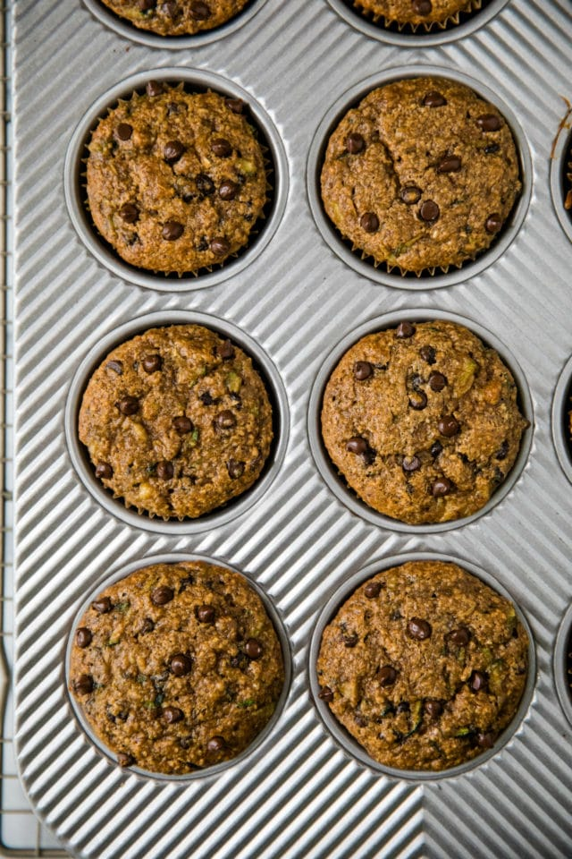Healthy Chocolate Chip Banana Zucchini Muffins in a muffin baking pan
