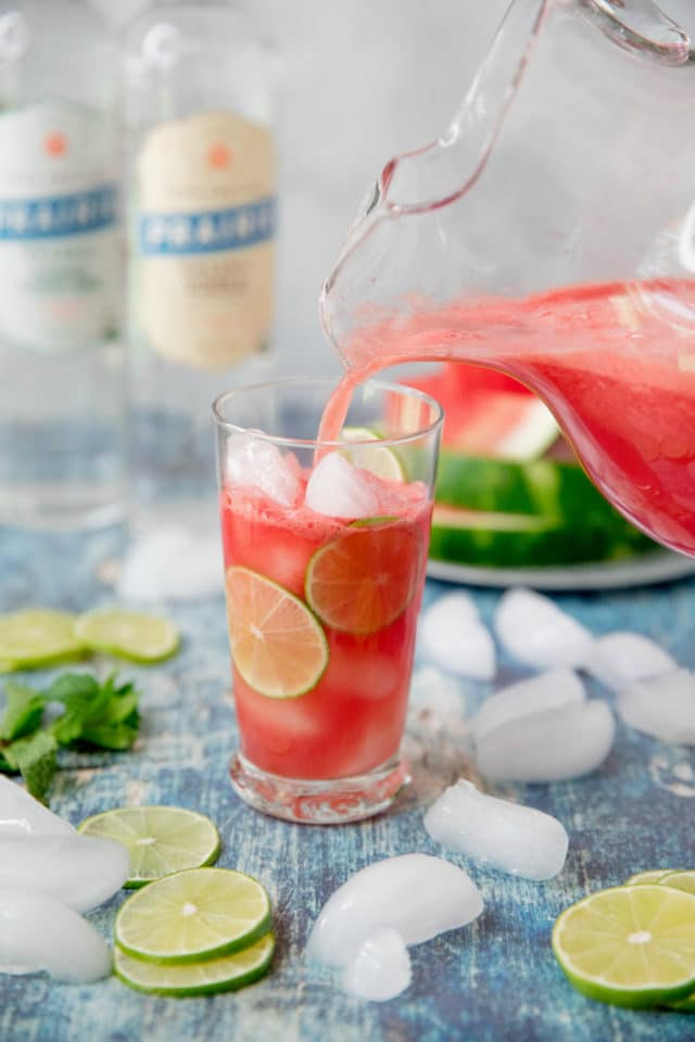 pitcher pouring Vodka Watermelon Cocktail in a glass with ice