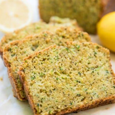 slices of Lemon Zucchini Bread near a sliced lemon