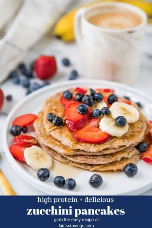 Protein Zucchini Pancakes topped with fruit, almond butter and maple syrup