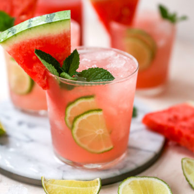 vodka watermelon cocktails garnished with a watermelon slice and fresh mint