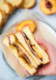 hand holding Peach Ham Grilled Cheese Sandwich