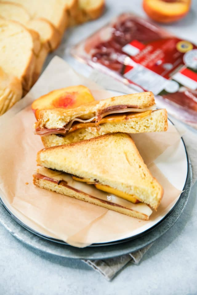 grilled cheese with peaches on a plate