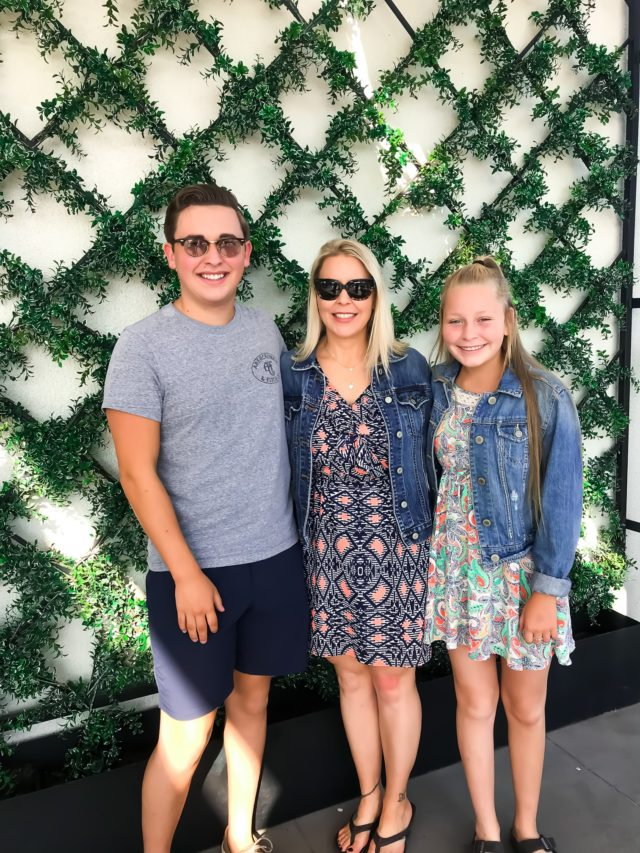 picture of three people in front of greenery at magnolia table