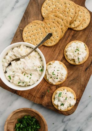 tuna salad served in a small bowl with crackers