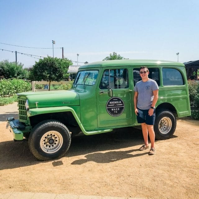 picture of boy in front of green truck at magnolia market