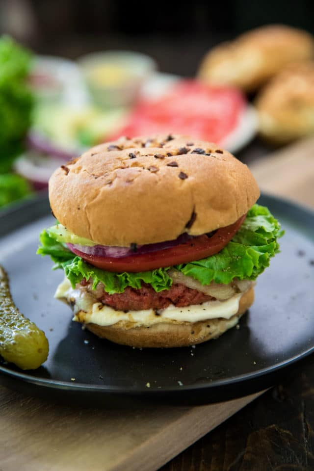 Best Veggie Burgers on a plate with a pickle