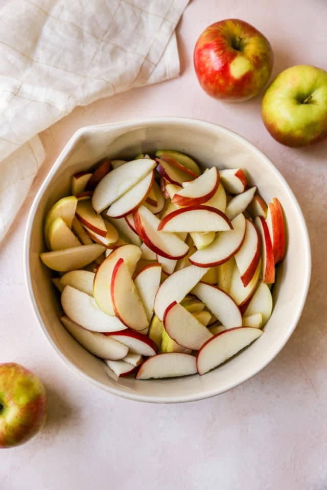 thinly sliced apples in a bowl