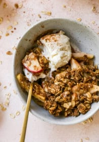 spoonful of apple crisp and vanilla ice cream