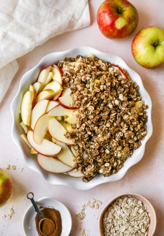 covering apple slices with oat mixture for apple crisp