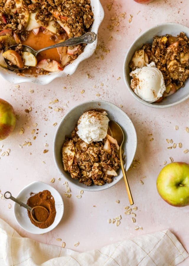 easy apple crisp served in bowls with vanilla ice cream