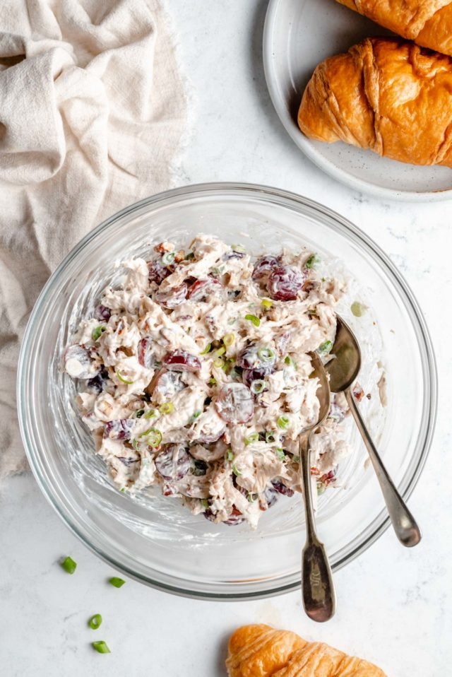 chicken salad with grapes in a large glass mixing bowl