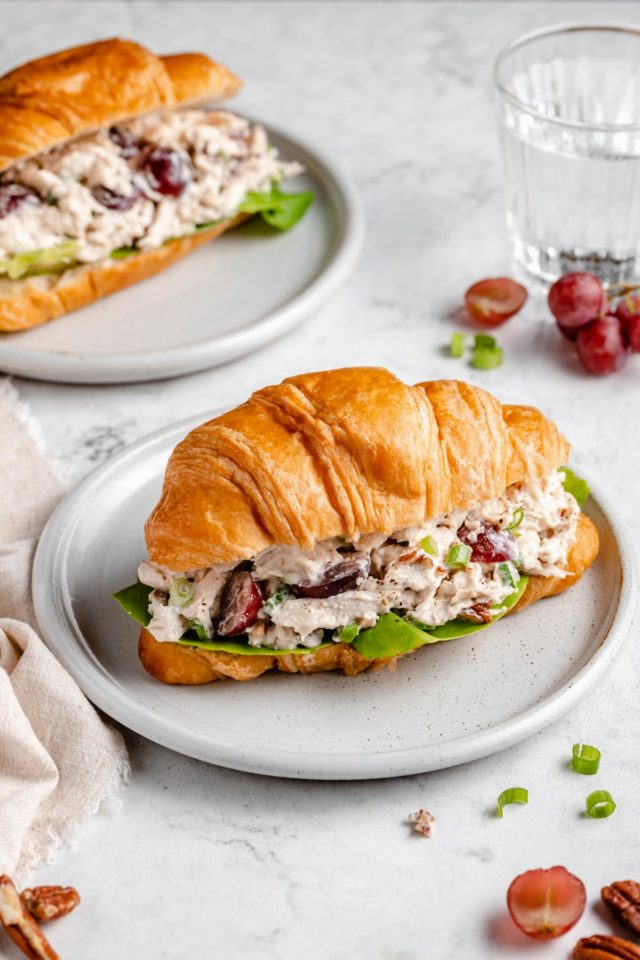 chicken salad with grapes served on a croissant
