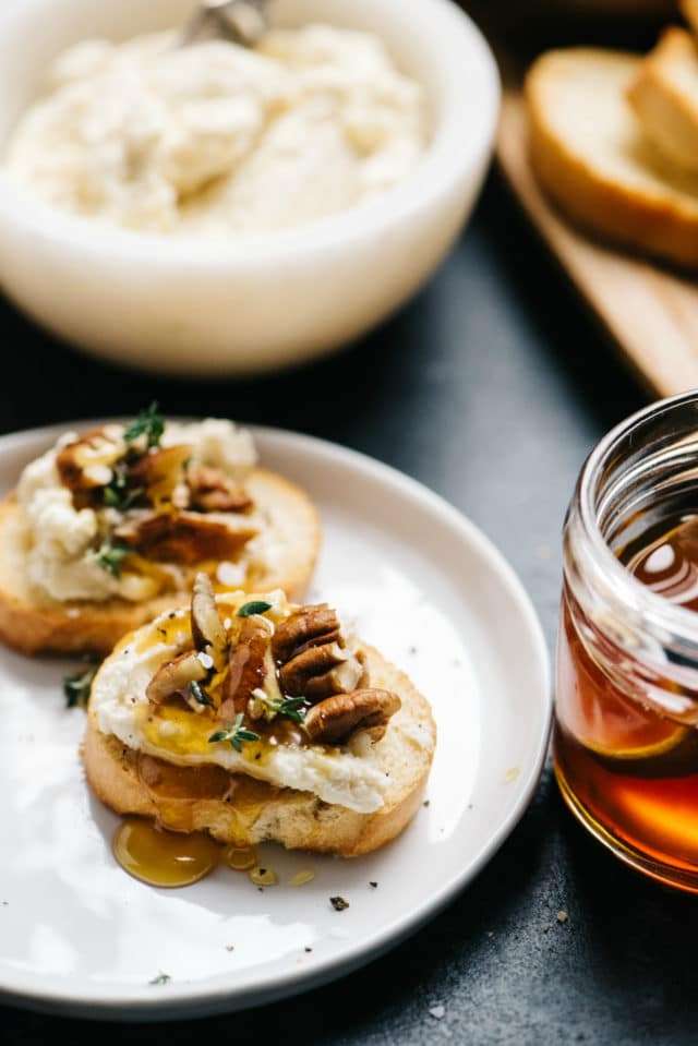 crostini topped with goat cheese, pecans, thyme and honey
