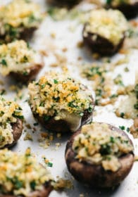 stuffed mushrooms on a baking sheet pan