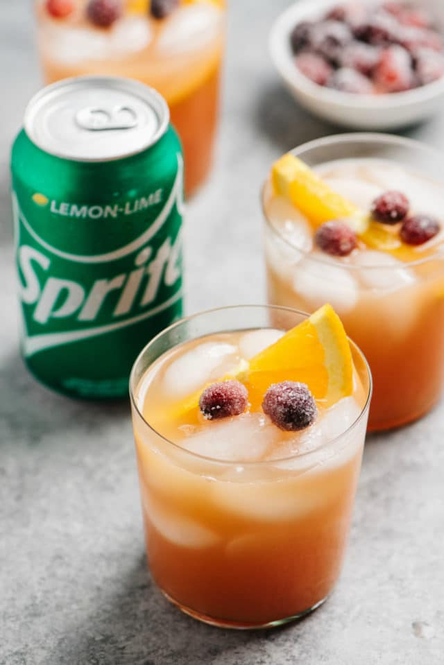 Vodka Cranberry Cocktail near a can of Sprite