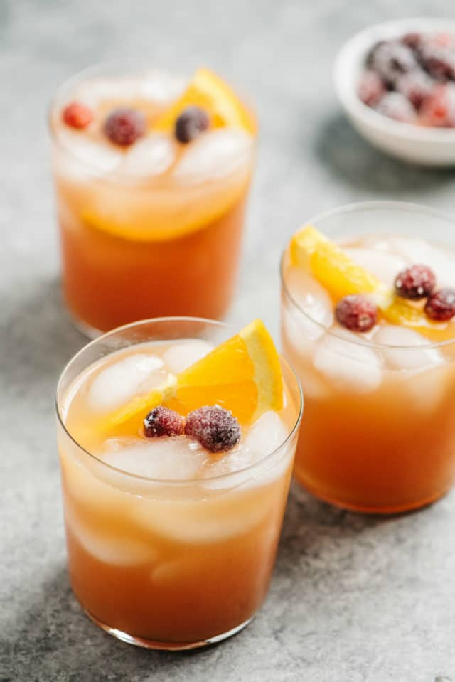 Vodka Cranberry Cocktails garnished with sugared cranberries and orange slices