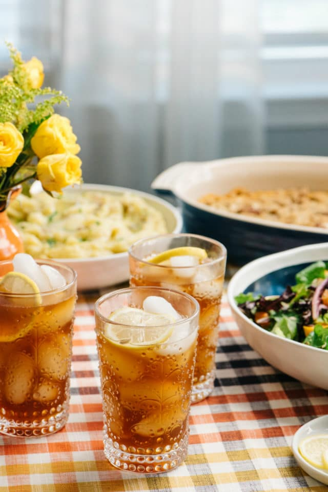 iced tea with lemon on a dinner table with dishes