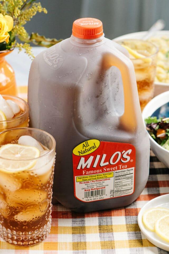 Milo's gallon jug on a table with holiday food