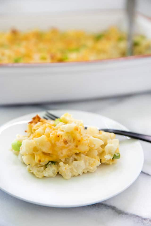Cheesy Potato Casserole served on a white plate with a fork