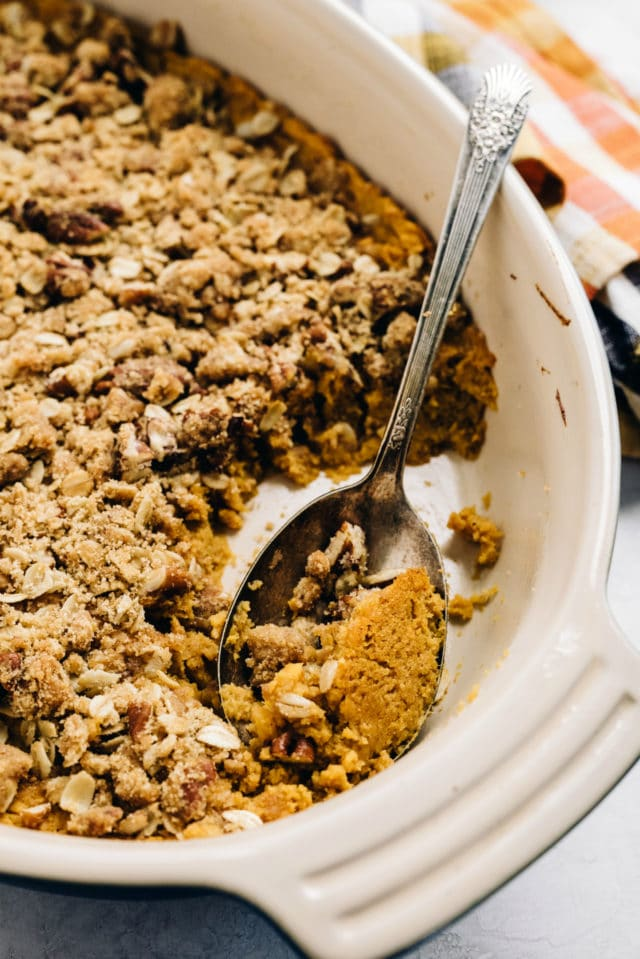 a spoon dishing out sweet potato casserole