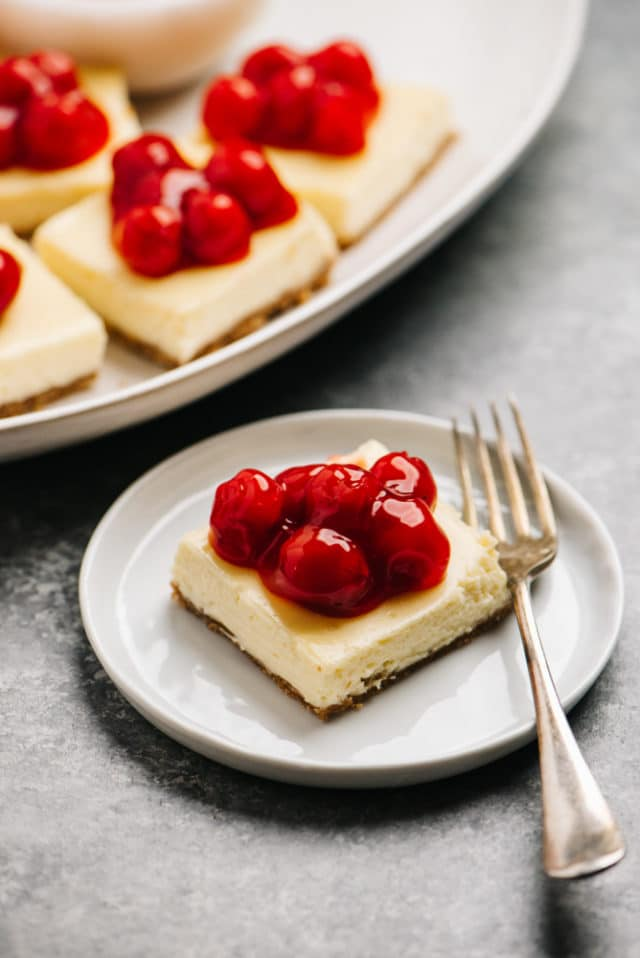 cheesecake bars topped with cherries