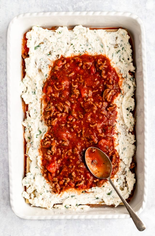 making an easy lasagna recipe by layering the ingredients in a lasagna dish