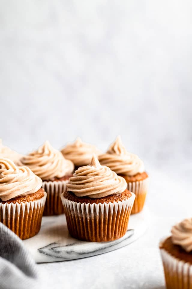pumpkin cupcakes made from scratch and topped with cream cheese frosting