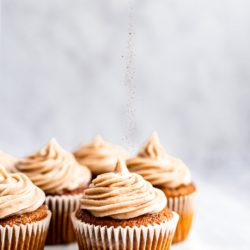 homemade pumpkin cupcakes with frosting and sprinkle of cinnamon