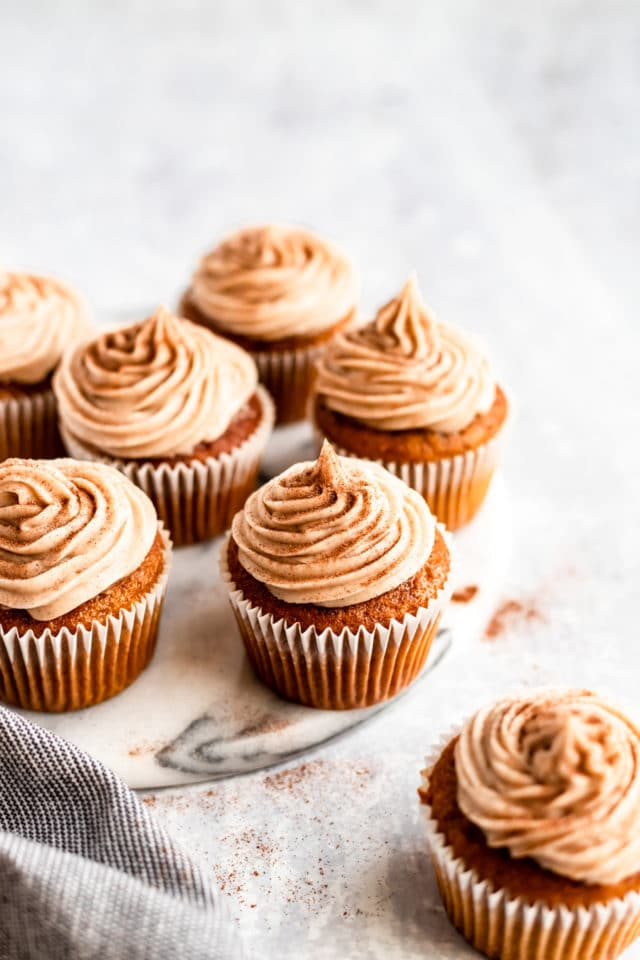 homemade pumpkin cupcakes served on a marble counter