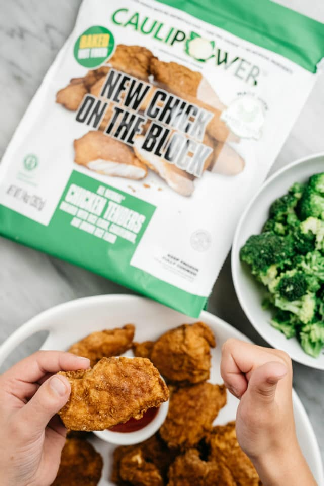 child's hand giving thumbs up over new CAULIPOWER chicken tenders