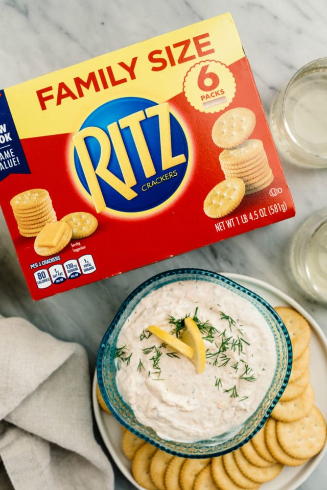 salmon dip in a serving bowl near a box of Ritz crackers