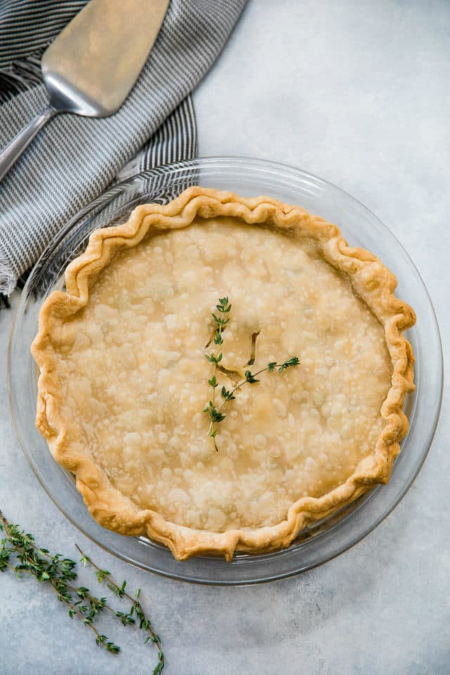 baked chicken pot pie garnished with fresh thyme