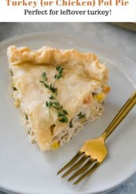 a slice of turkey pot pie on a white plate