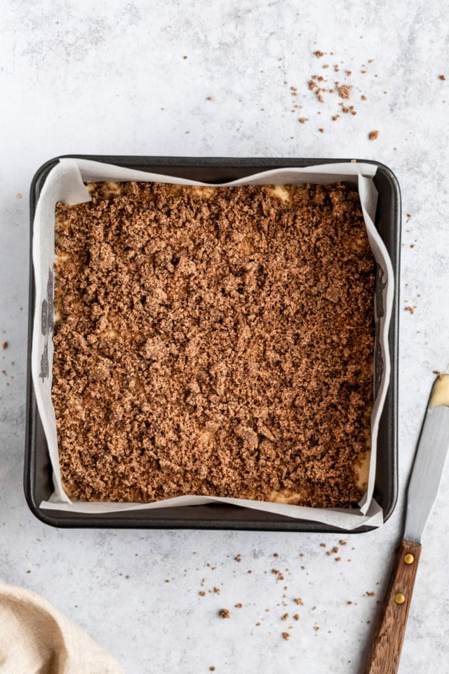 sprinkle the cinnamon sugar streusel over the top of the cake