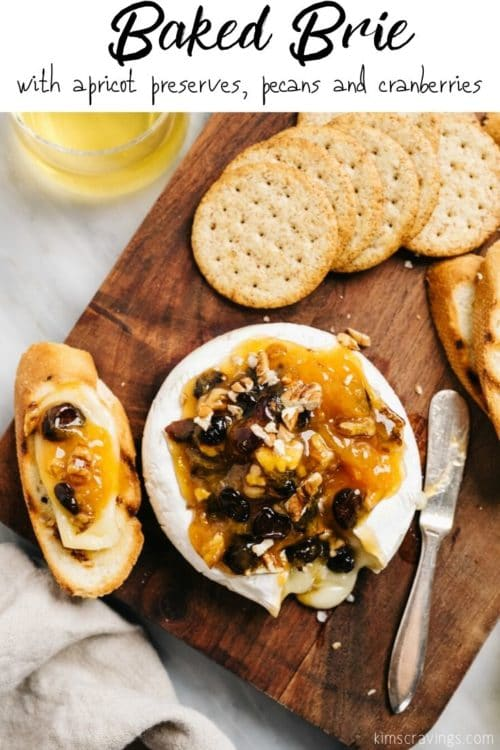 Baked Brie served with crackers and wine