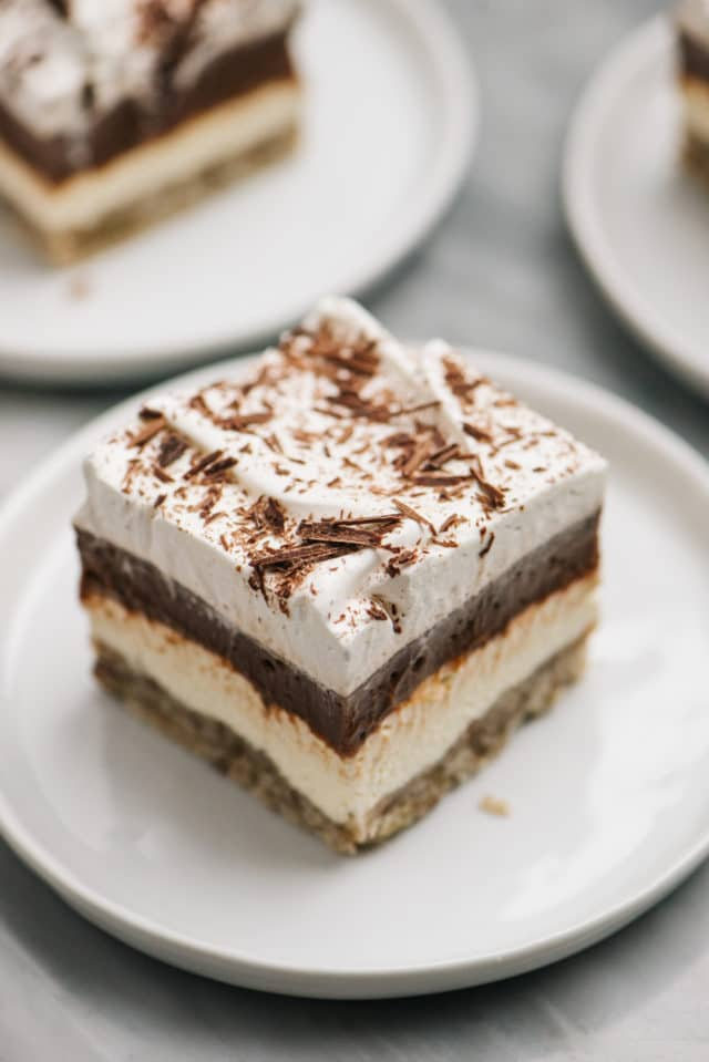 chocolate cream cheese dessert with layers served on a small white plate