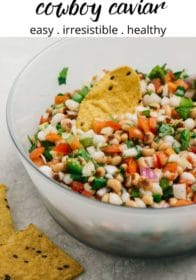 cowboy caviar dip served in a big bowl with tortilla chips